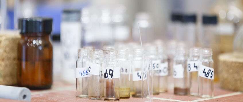 Small sample bottles on laboratory table